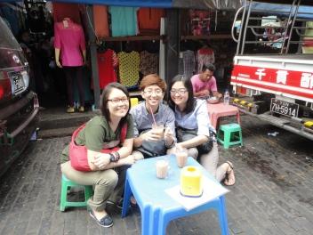Here we are enjoying our tea between 2 vans in Bogyoke Market